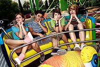 Teenagers posing on amusement park ride
