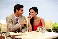 Couple at seaside cafe table