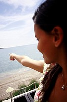 Woman pointing out to sea