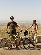 Hispanic couple with bicycles