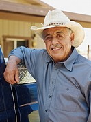 Senior Hispanic man wearing cowboy hat