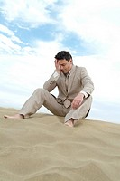 Man, suit, beach, sitting, seriously, knocked down,