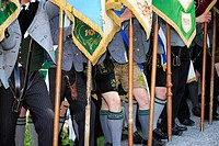 Germany, Bavaria, Fischbachau, birch-stone, Feast of Corpus Christi-day, pilgrims, men, official dress, detail, legs, flags, Upper Bavaria, Leitzachta...