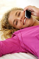 Woman, young, bed, lie, cell phone, telephones, cheerfully, detail, series, people, blond, curls, telephone, smiling, cheerfully, falling in love, hap...