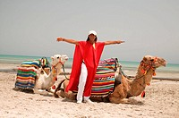 Tunisia, Djerba, sandy beach, camel-drivers, camels, resting, Mediterranean, beach, beach, man, cheerfully, laughs, fun, animals, camels, dromedaries,...