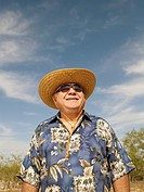 Senior Mixed Race man wearing sunhat