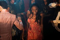 African woman dancing at nightclub