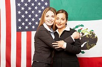 Hispanic businesswomen hugging