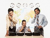 Indian businessmen talking on telephones