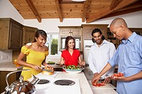 Multi-ethnic couples preparing food