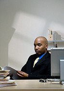 African American businessman holding paperwork