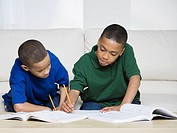 African American brothers doing homework