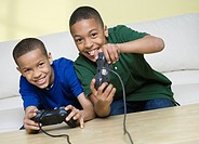 African American brothers playing video games