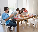 Hispanic family at breakfast table