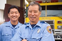 Asian male paramedics in front of ambulance (thumbnail)