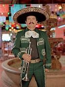 Hispanic mariachi musician holding trumpet