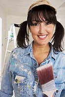 Middle Eastern woman holding paint brush (thumbnail)
