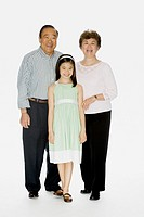 Portrait of Asian grandparents and granddaughter