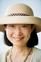 Asian woman wearing straw hat