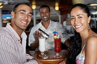 Hispanic couple at bar