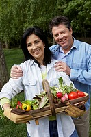 Hispanic couple with basket of vegetables