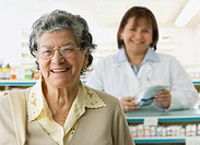 Senior Hispanic woman in pharmacy
