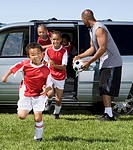Multi-ethnic children in soccer uniforms (thumbnail)