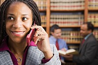 African American businesswoman talking on cell phone