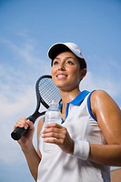Hispanic woman holding tennis racket