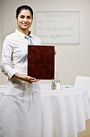 Indian waitress holding menu