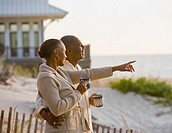 Senior African American couple pointing at beach