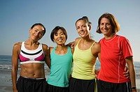 Multi-ethnic female runners at beach