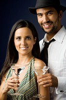 Hispanic couple holding cocktails