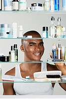 African man looking in medicine cabinet