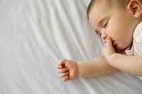 Sleeping baby sucking finger