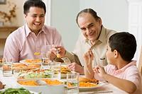 Hispanic family at dinner table