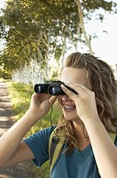 Teenage girl using binoculars