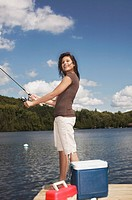 Teenage girl fishing