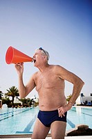Senior man swimmer yelling into bullhorn