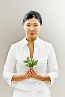 Asian woman holding flower
