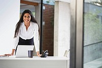 Confident businesswoman with a laptop computer