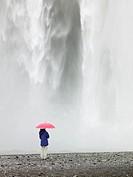 Hispanic woman in front of waterfall