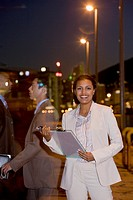 African American businesswoman holding clipboard