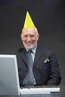 Businessman wearing party hat