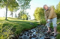 Golfer in a stream