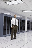 Businessman standing in server room (thumbnail)