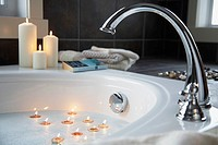 Tealights floating in bathtub