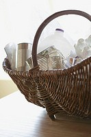 Recycling containers in basket