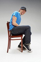 Happy young man sitting on a chair