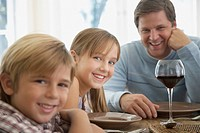Man and two kids at dining room table